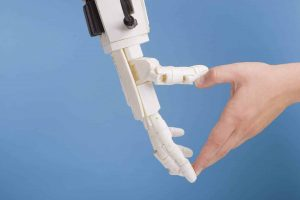human-and-robot-hands-making-heart-gesture-on-23DE9YX-scaled