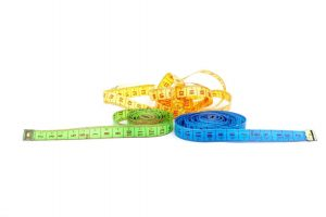 three-measuring-tapes-of-different-colors-PF4TJVS-scaled